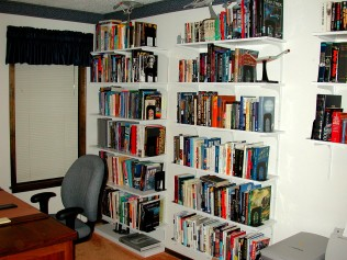 Some of the 33 bookshelves that once lined my study