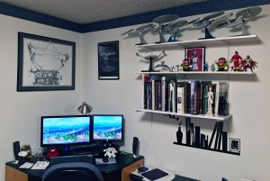 Computer desk with big books, Starfleet, and other toys