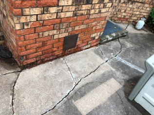 Spalling chimney bricks and patio cracks