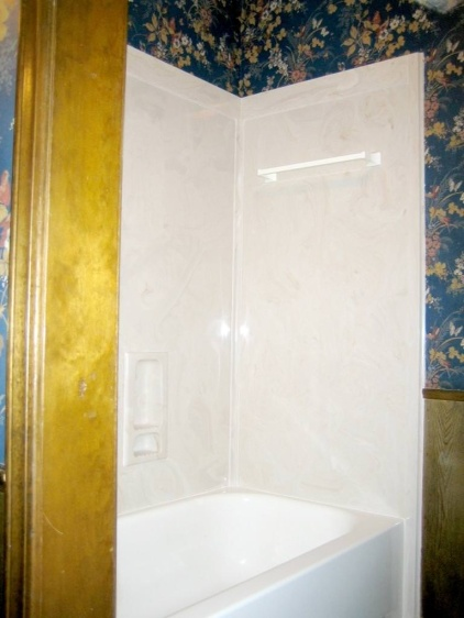 The Quarry installed the new shower walls. Notice how the awful wallpaper remained unchanged.